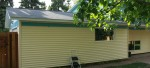 New window and siding on the side of the garage
